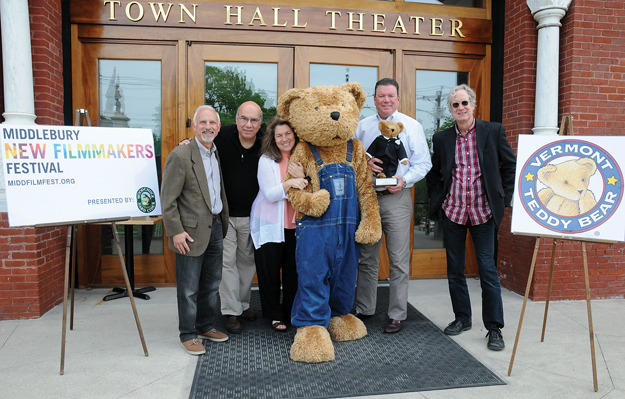 ORGANIZERS OF THE Middlebury New Filmmakers Festival, scheduled for Aug. 27-30, announced during a press conference last Friday that Vermont Teddy Bear has signed on as a sponsor and creator of the VTeddy Award statuette that will be handed out to winning filmmakers. Pictured are, left to right, festival producer Lloyd Komesar; festival board members Jay Parini and Gerianne Smart; Vermont Teddy Bear President and CEO Bill Shouldice; and Town Hall Theater Executive Director Doug Anderson. Independent photo/Trent Campbell